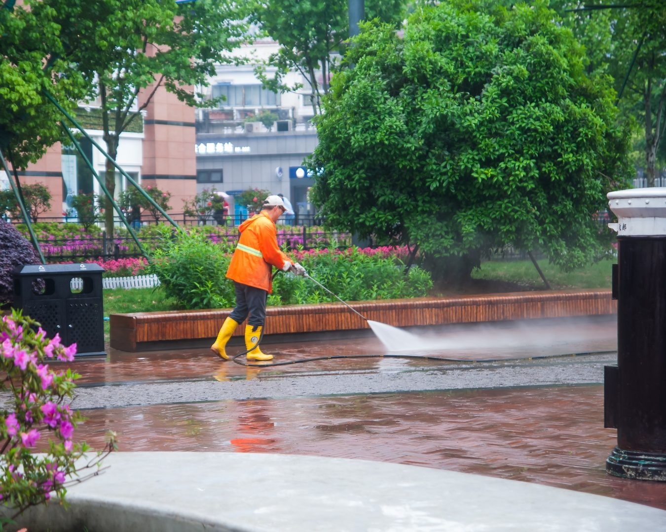 worker washing the pavement road in Wuhan, China